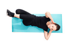 Fit woman doing crunches on exercise mat Stock Image