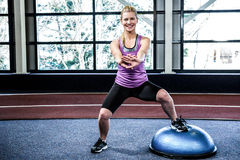 Fit woman doing exercise with bosu ball Royalty Free Stock Image