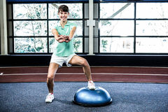Fit woman doing exercise with bosu ball Stock Images