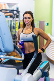 Fit woman doing exercise on a elliptical trainer. Royalty Free Stock Photography