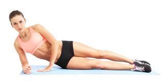 Fit woman doing exercise - isolated over white background Royalty Free Stock Image