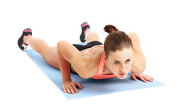 Fit woman doing exercise - isolated over white background Stock Photos