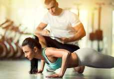 Fit woman doing exercises Royalty Free Stock Photography