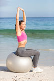 Fit woman doing fitness on exercise ball Royalty Free Stock Photo