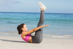 Fit woman doing fitness beside the sea Stock Photography