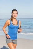 Fit woman doing jogging Stock Photo