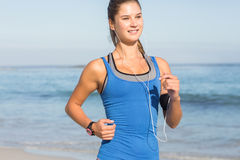 Fit woman doing jogging Stock Photography