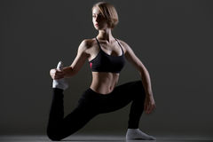 Fit woman doing low lunges Royalty Free Stock Images