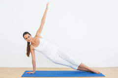 Fit woman doing pilate exercises in the fitness studio royalty free stock photography
