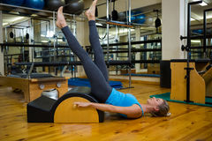 Fit woman doing pilates on arc barrel Stock Images