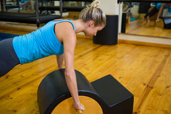Fit woman doing pilates on arc barrel Royalty Free Stock Photos