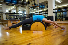 Fit woman doing pilates on arc barrel Royalty Free Stock Images