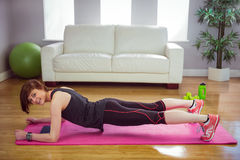 Fit woman doing plank on mat Royalty Free Stock Images