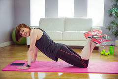 Fit woman doing press up on mat Stock Photo
