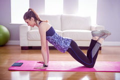 Fit woman doing press up on mat Royalty Free Stock Photo