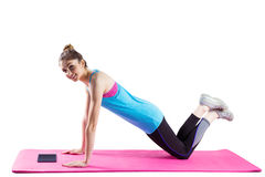 Fit woman doing press up on mat Royalty Free Stock Photography