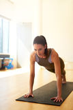 Fit woman doing press ups Royalty Free Stock Image