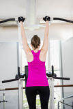 Fit woman doing pull up. At the gym stock images