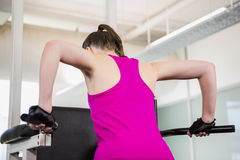 Fit woman doing pull up. At the gym royalty free stock images