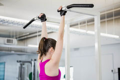 Fit woman doing pull up. At the gym stock photos