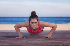 Fit woman doing push up or press up Royalty Free Stock Images