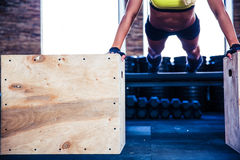 Fit woman doing push ups on fit box Royalty Free Stock Photography