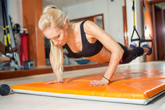 Fit woman doing push-ups Stock Images