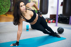 Fit woman doing side plank yoga pose Concept stock image