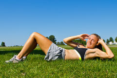 Fit woman doing sit ups Royalty Free Stock Photos