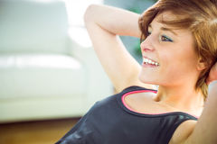 Fit woman doing sit ups Stock Photo