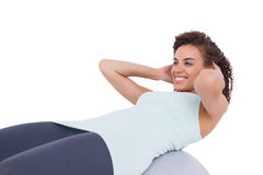 Fit woman doing sit ups Stock Image