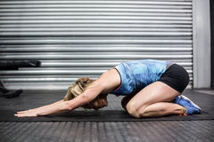 Fit woman doing some stretch. At crossfit gym Stock Images