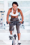 Fit woman doing spinning Stock Photos