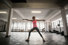 Fit woman doing stretching exercise Stock Images