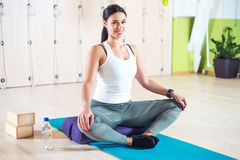 Fit woman doing stretching pilates exercises in Royalty Free Stock Image