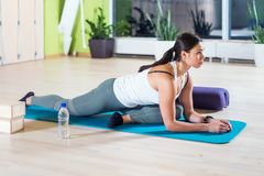 Fit woman doing stretching pilates exercises in fitness studio. Fit woman doing stretching pilates exercises in fitness studio Royalty Free Stock Photo