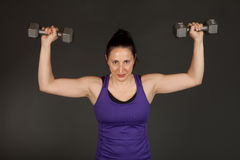 Fit woman doing weight training Stock Photos