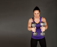 Fit woman doing weight training Royalty Free Stock Photos