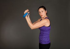 Fit woman doing weight training Royalty Free Stock Photography