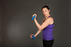 Fit woman doing weight training Stock Photo