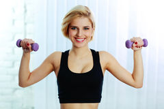 Fit woman doing workout with dumbbells Stock Image
