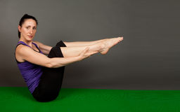 Fit woman doing yoga Stock Image