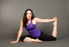 Fit woman doing yoga Royalty Free Stock Image