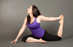 Fit woman doing yoga Royalty Free Stock Images