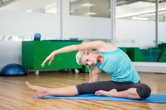 Fit woman doing yoga on mat Stock Images