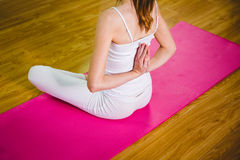 Fit woman doing yoga on mat Stock Photography