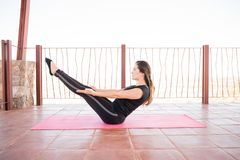 Fit woman doing yoga workout stock image