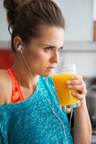 Fit woman drinking pumpkin smoothie in kitchen Royalty Free Stock Image