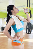 Fit woman drinking water at gym Royalty Free Stock Photo