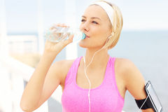 Fit woman drinking water Stock Photos